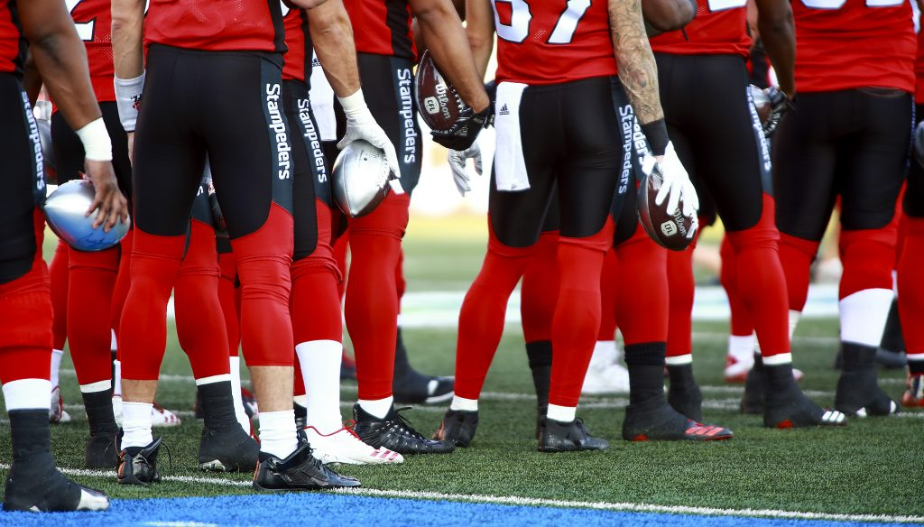Members of the Calgary Stampeders waited for the kick off against the Toronto Argonauts at McMahon Stadium on August 26, 2017.