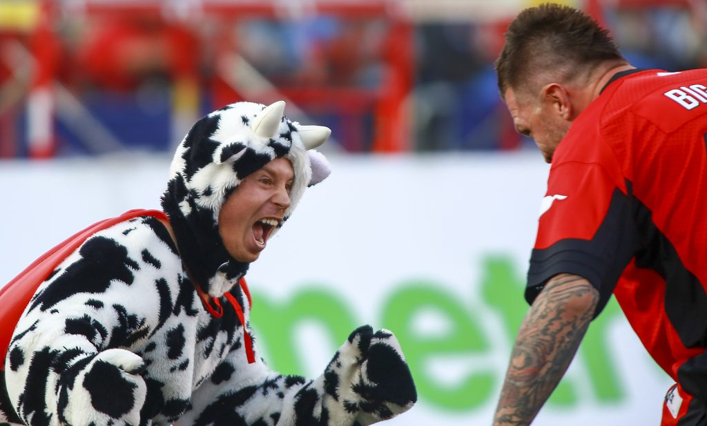 Former Calgary Flame Brian McGrattan raced the Cowboy's Worlds Fastest Cow during the Calgary Stampeders and Toronto Argonauts game at McMahon Stadium on August 26, 2017. The Cow won this rematch from last year.